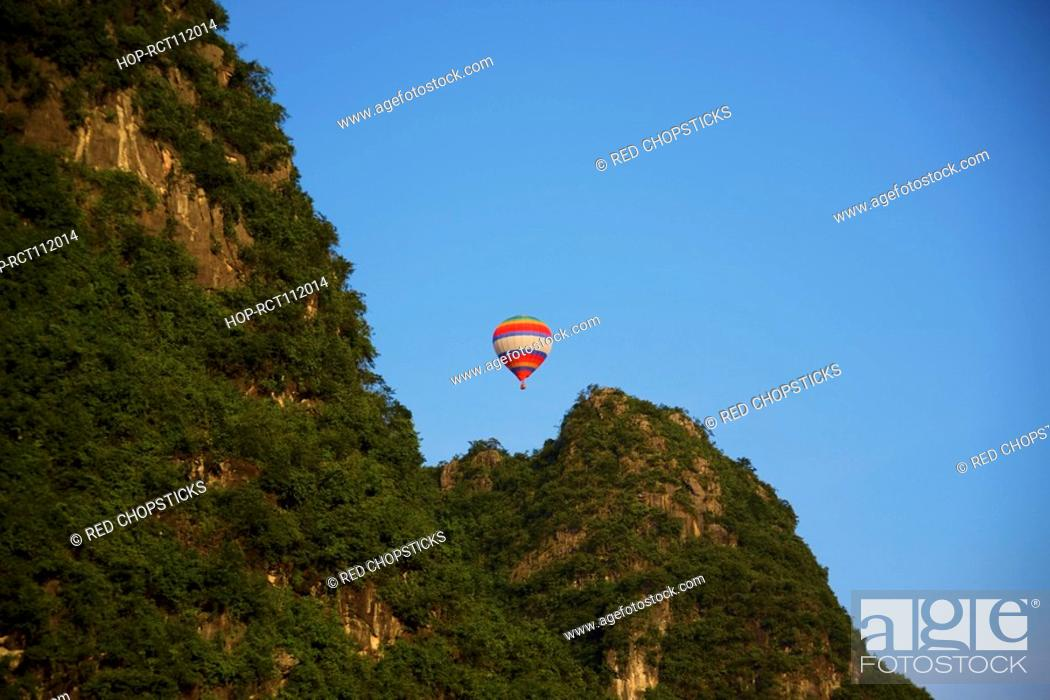 Stock Photo: Low angle view of a hot air balloon, Yangshuo, Guangxi Province, China.