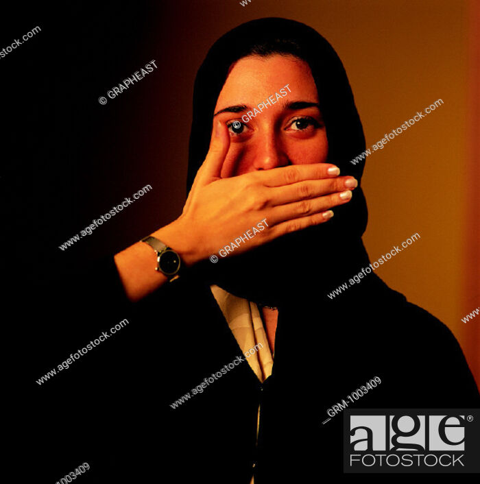 Stock Photo: Arab woman covering her mouth with hand.