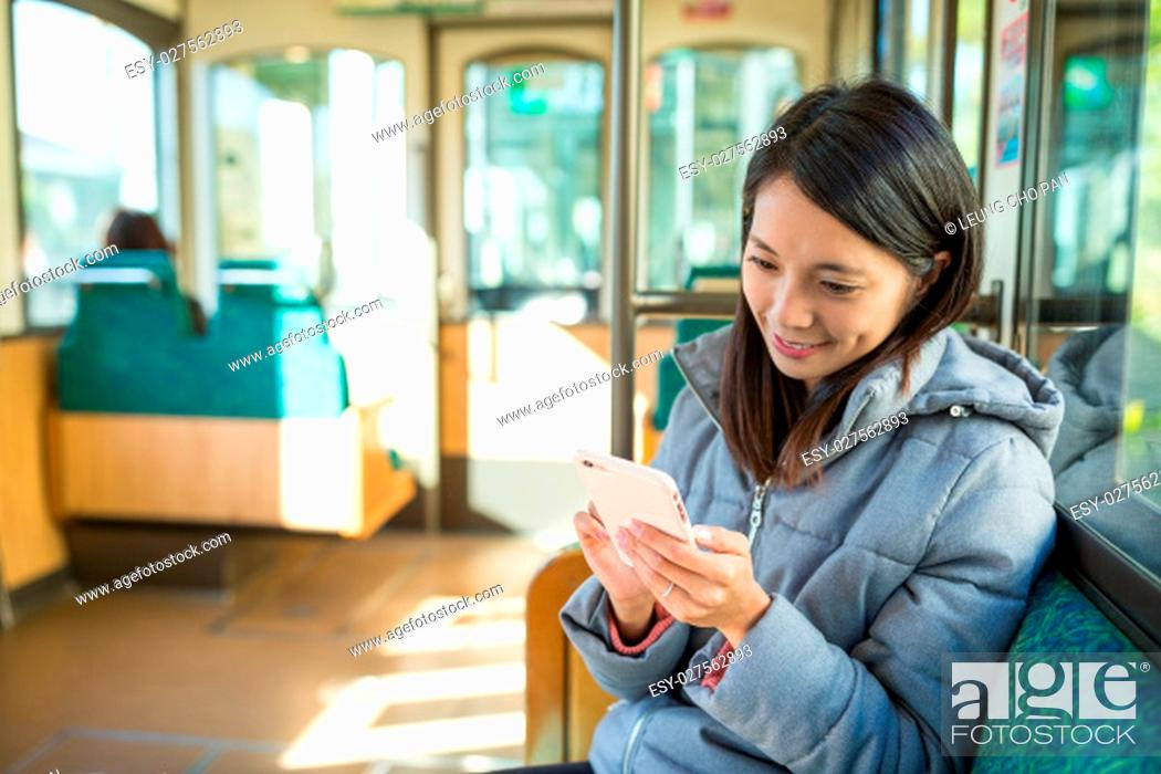 Stock Photo: Young woman sending sms on cellphone.