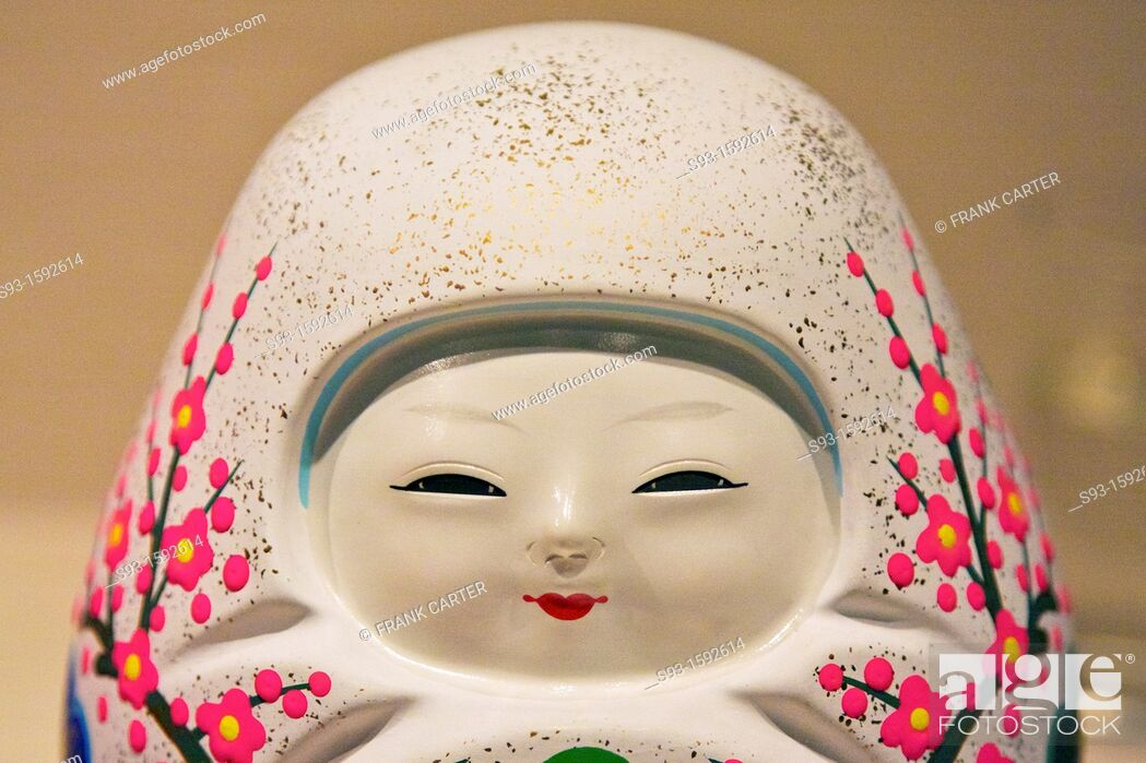 Stock Photo: A small ceramic doll with an asian face.
