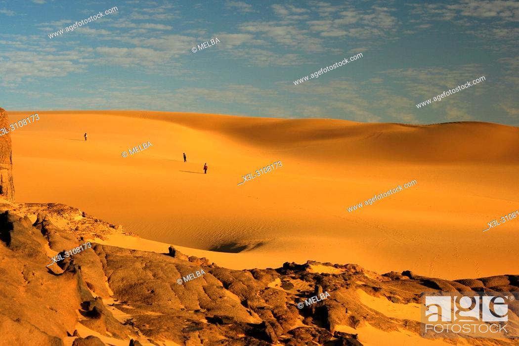 Stock Photo: Tourists in Tahaggart. Tassili Ahaggar. Sahara desert. Algeria.