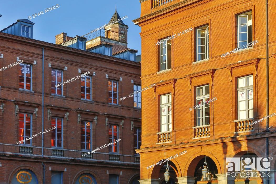 Stock Photo: France, Haute Garonne, Toulouse, listed at Great Tourist Sites in Midi-Pyrenees, Capitole Place, Le Capitole, sunny facades of brick buildings place.