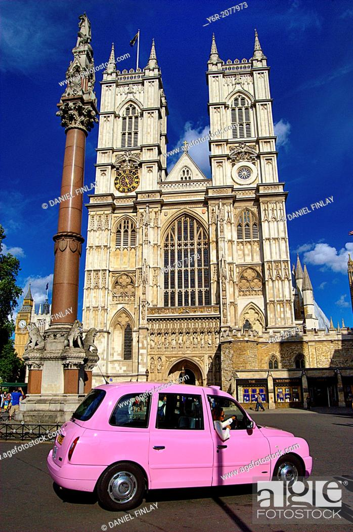 Stock Photo: Westminster Abbey in the heart of London, England, with a pink London taxi in the foreground, on a sunny Summer day. Female visitor posing for a picture in the.