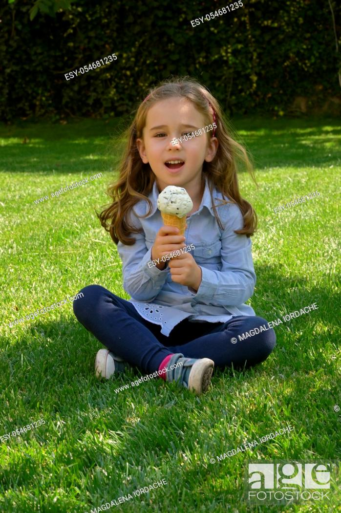 Stock Photo: Little Girl Singing with A Ice Cream Microphone In Waffle Cone.