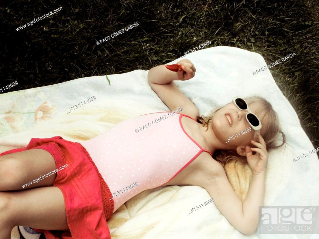 Stock Photo: Girl sunbathing.