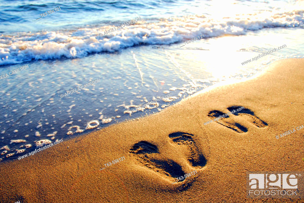 Stock Photo: couples footprints on beach,.