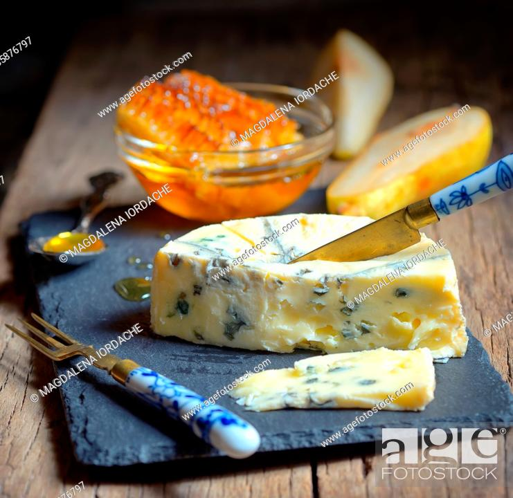 Stock Photo: Blue Cheese and honey on ardesia plate.