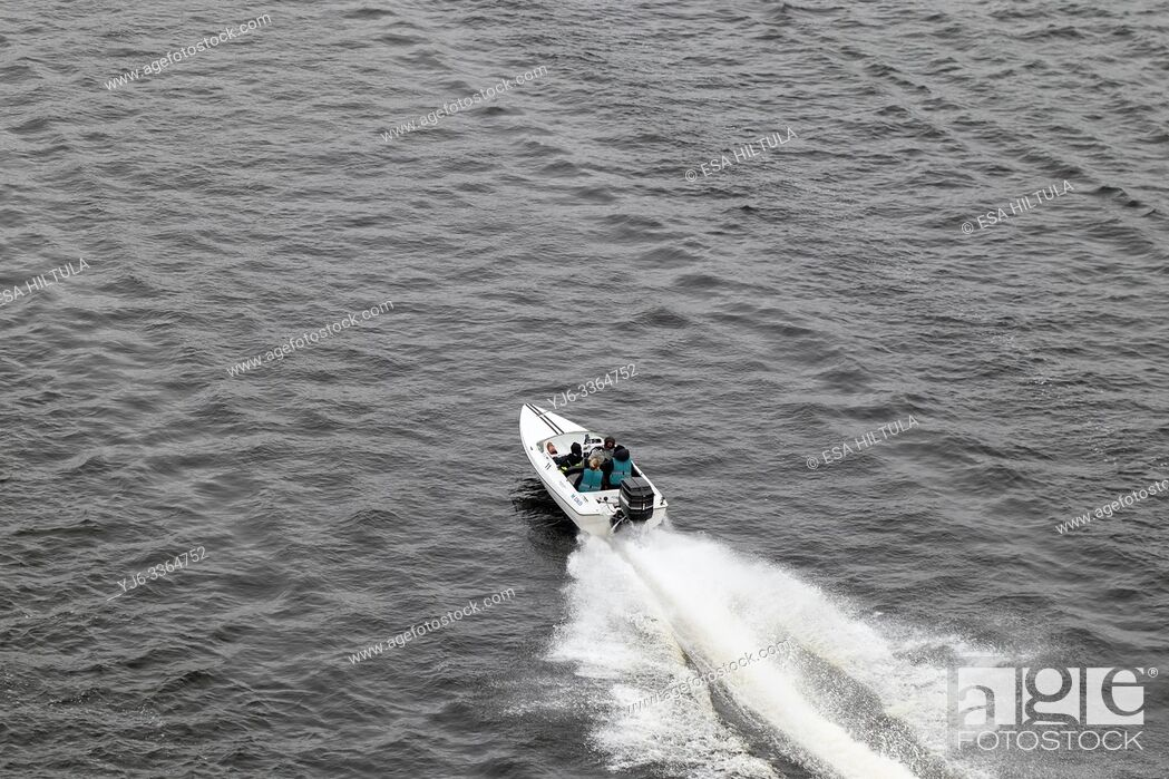 Stock Photo: Small speed boat speeding along lake Saimaa, Lappeenranta Finland.