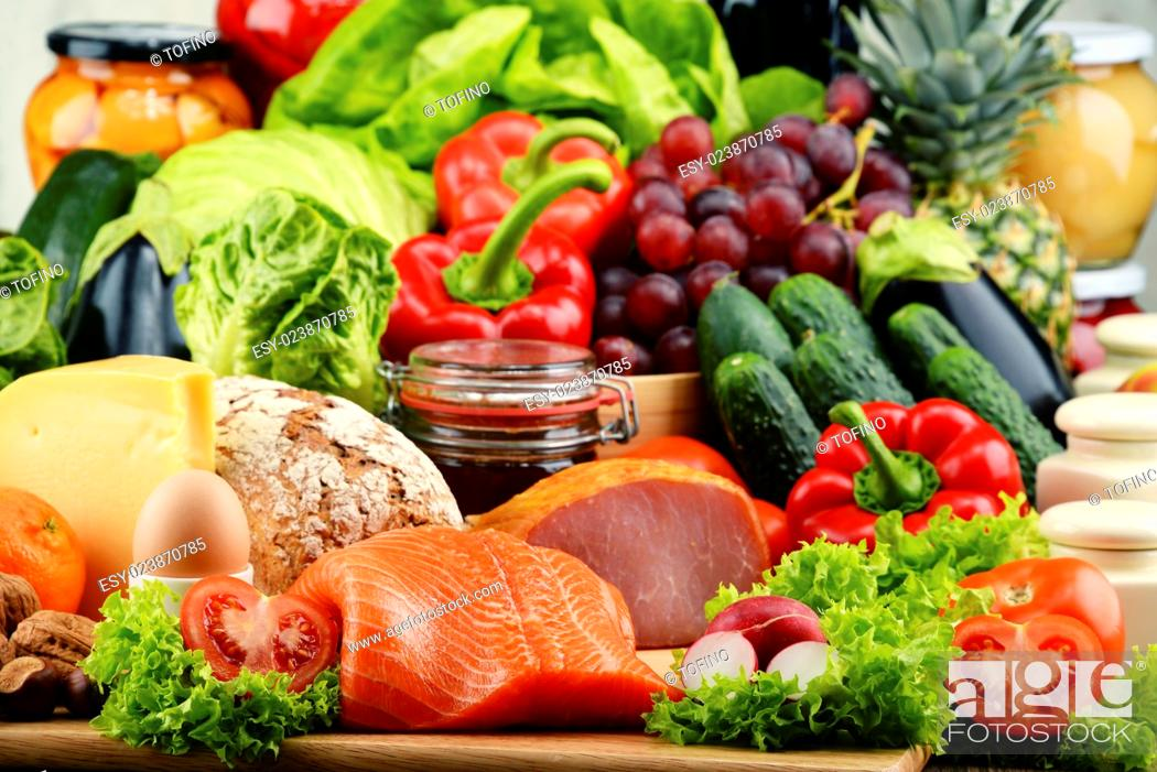 Stock Photo: Variety of organic food including vegetables fruit bread dairy and meat. Balanced diet.