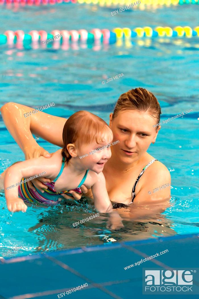 Stock Photo: mother and daughter in the pool.