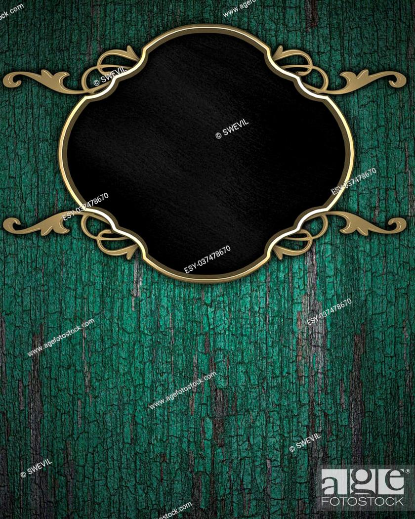 Stock Photo: Gold Pattern on a black plate on a wood background.