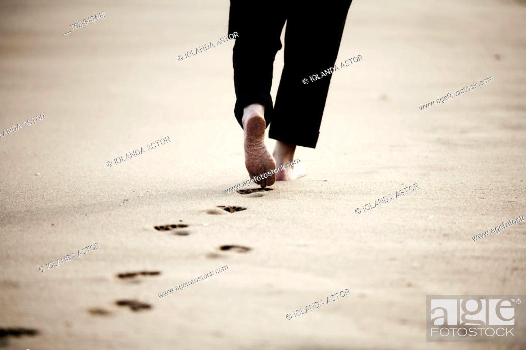 Stock Photo: Walking on the beach.
