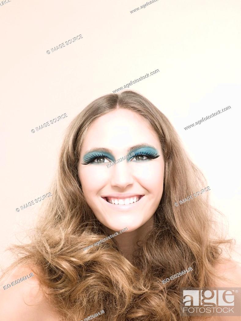 Stock Photo: A young woman wearing false eyelashes.