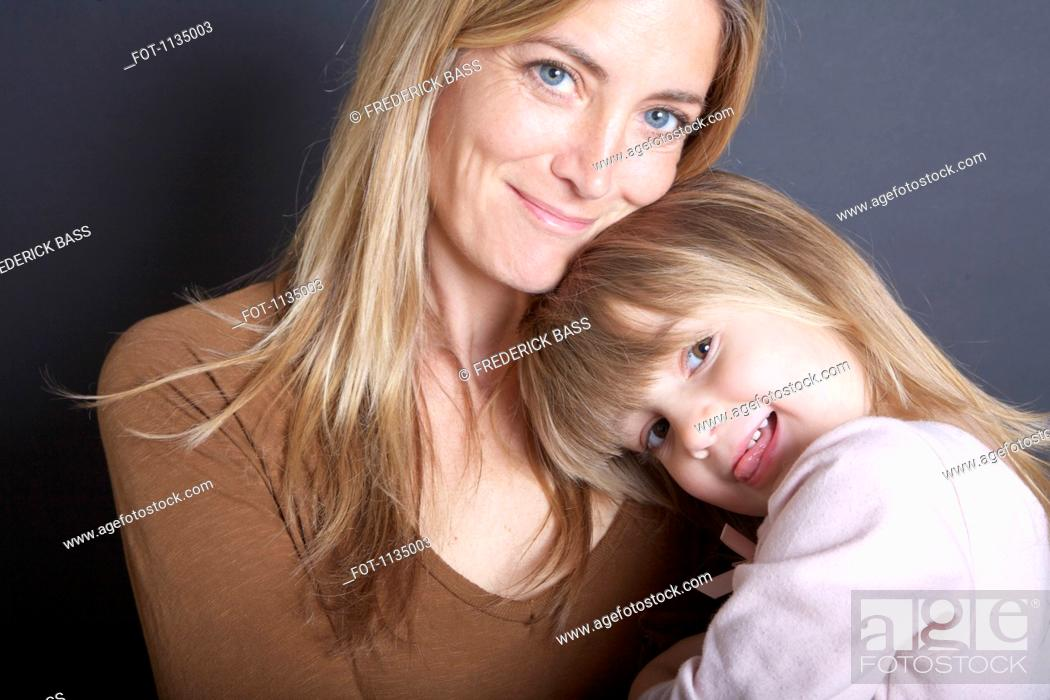 Stock Photo: A mother and her young daughter, portrait.