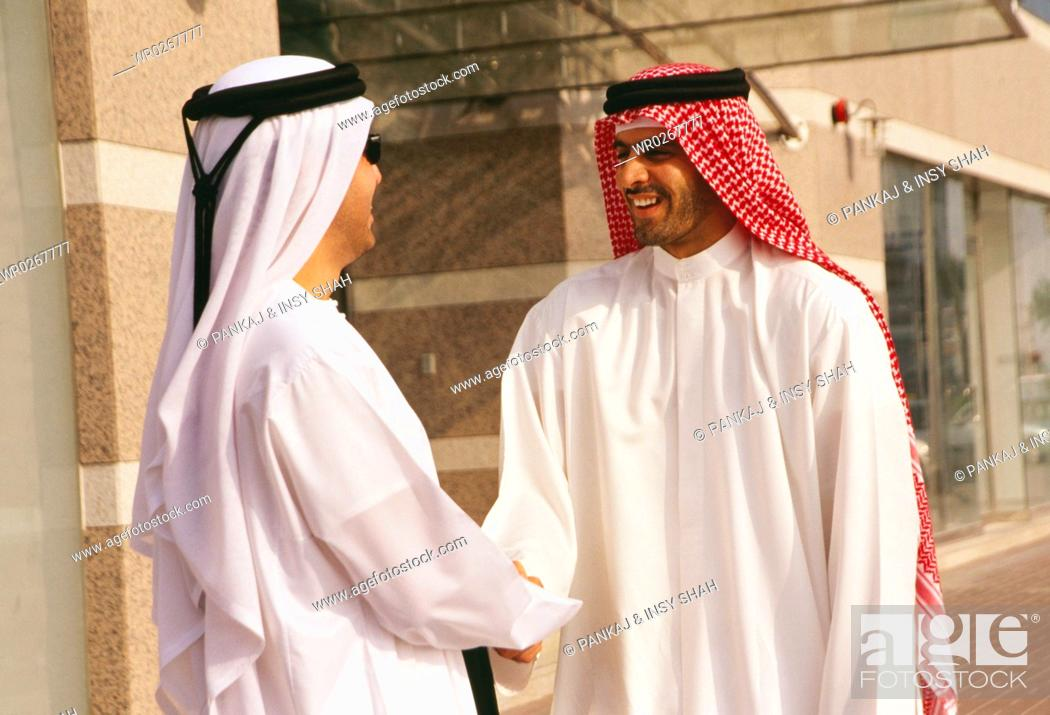 Two arabs greet each other outside the commercial building stock stock photo two arabs greet each other outside the commercial building m4hsunfo