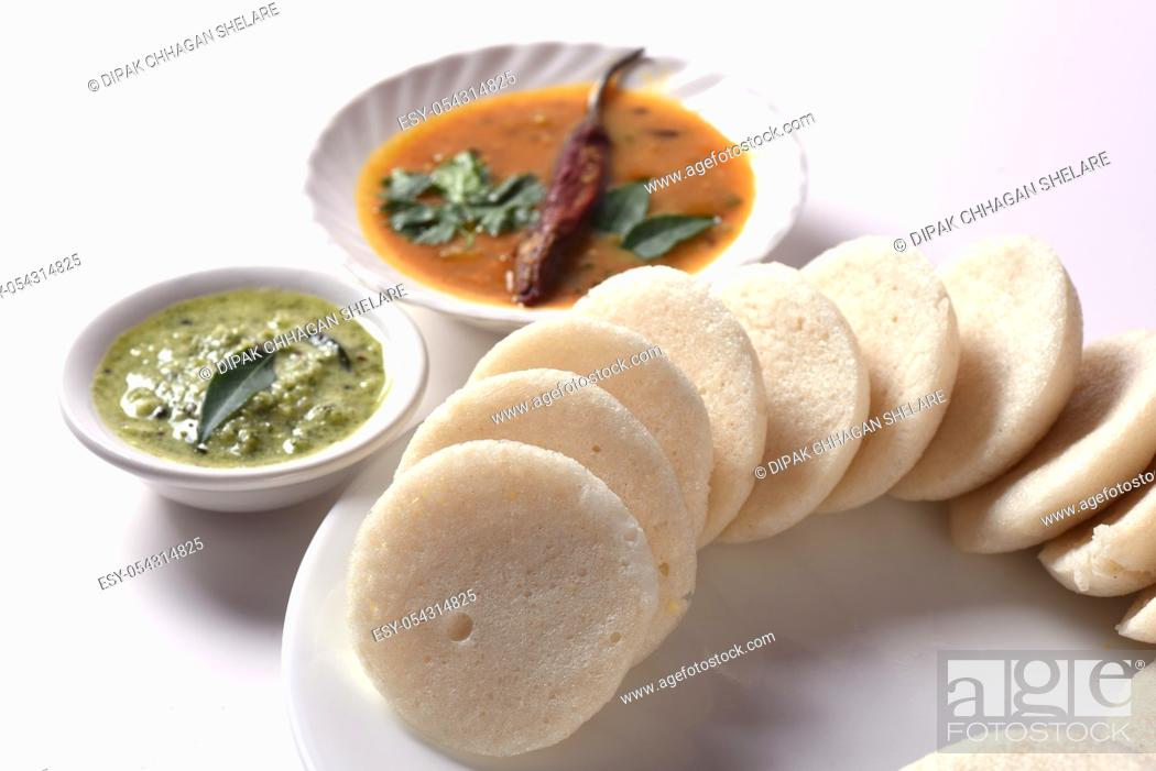 Stock Photo: Idli with Sambar and coconut chutney, Indian Dish : south Indian favourite food rava idli or semolina idly or rava idly, served with sambar and green coconut.