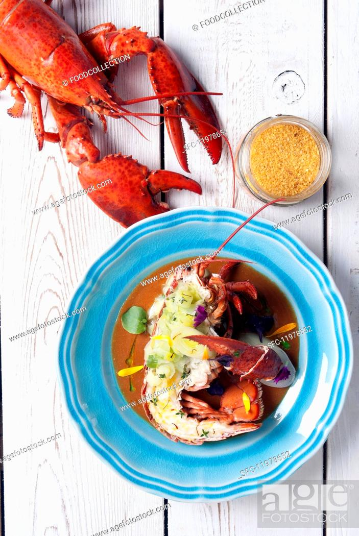 Stock Photo: Lobster bisque with a grilled lobster.