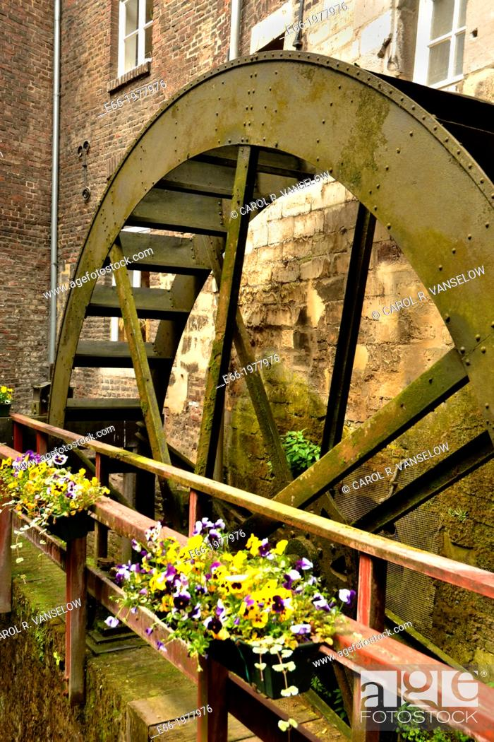 Stock Photo: The Bisschopsmolen is located in the heart of Maastricht. It is the oldest working water mill in the Netherlands. The earliest mention of this water mill on the.