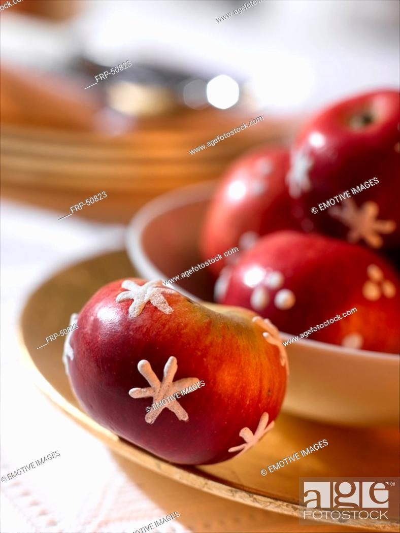 Stock Photo: Red apples with a icing sugar pattern.