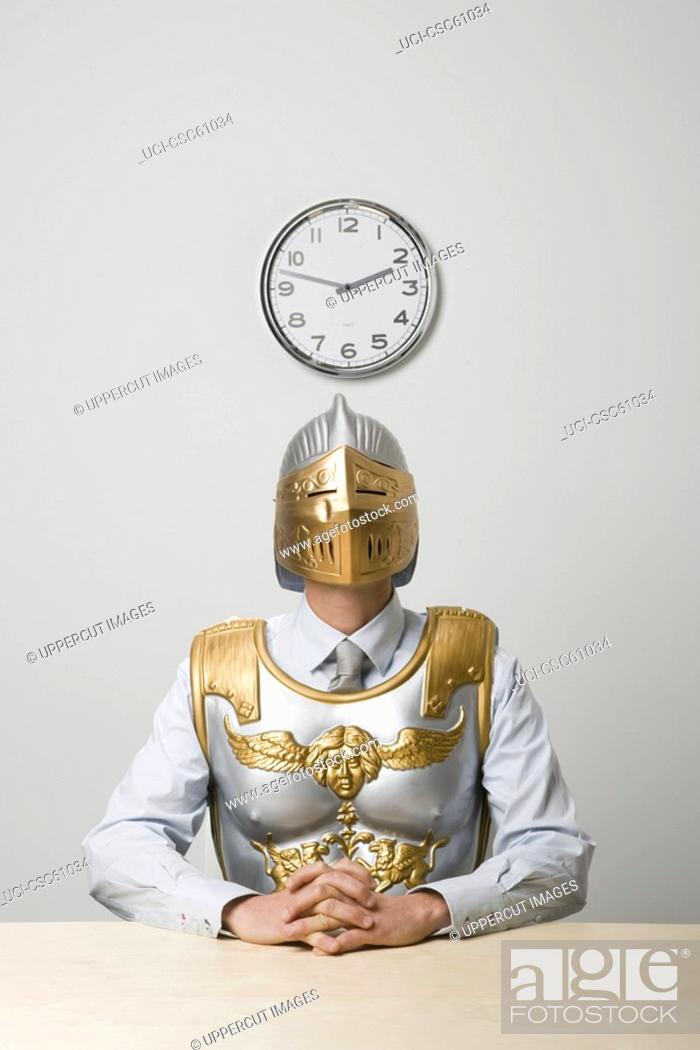 Stock Photo: Businessman wearing gladiator armor.