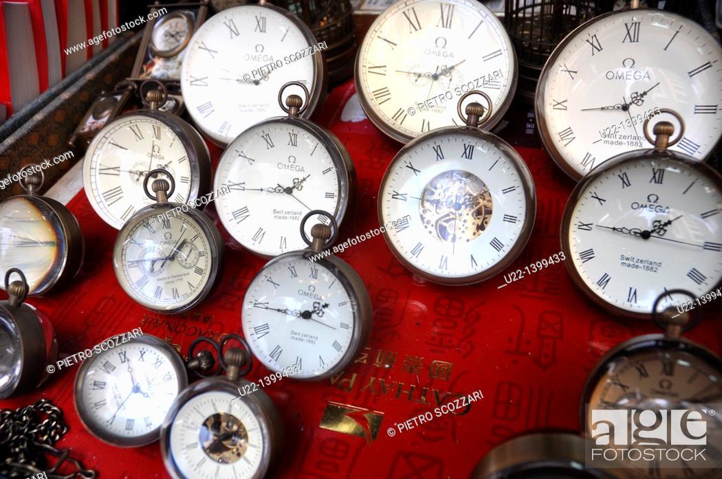 Stock Photo: Hong Kong: old pocket watches sold at 'Cat Street' (Upper Lascar Row) antique market, Sheung Wan.