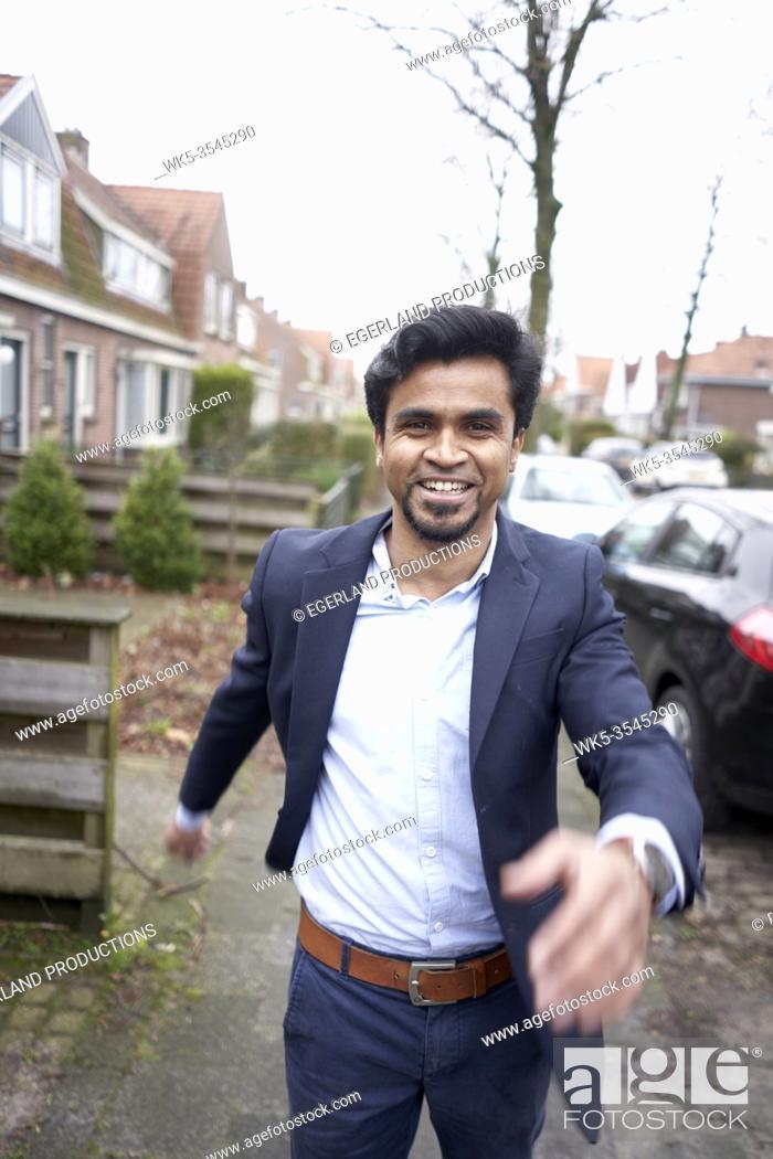 Stock Photo: proactive Indian business man in Leeuwarden, Friesland, Netherlands, Europe.