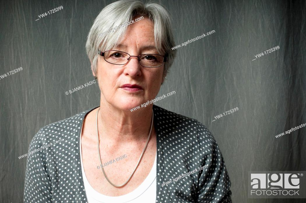 Stock Photo: Portrait of middle aged woman with glasses.