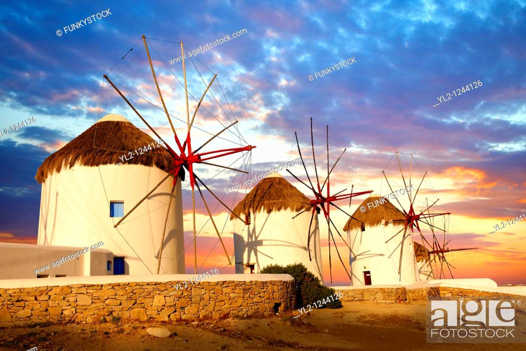 Stock Photo: Sunset over the traditional Greek windmills of Mykonos Chora  Cyclades Islands, Greece.