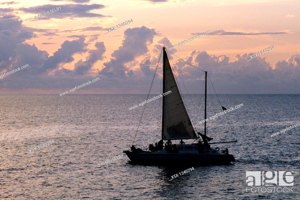 Stock Photo: Sailboat at sunset off the coast of Negril, Jamaica.