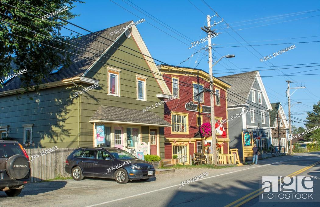 Stock Photo: Canada Mahone Bay Nova Scotia small village with shops and traffic on Main Street in relaxing tourist town.