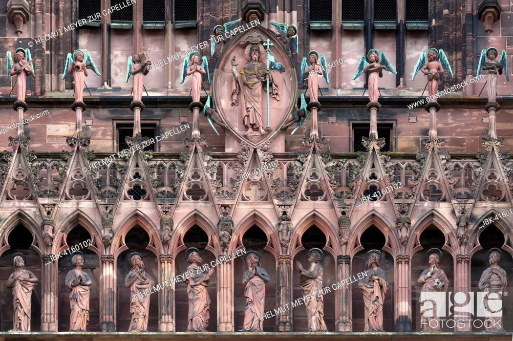 Stock Photo: Religious sculptures above the entrance of the Strasbourg Cathedral, Alsace, France.