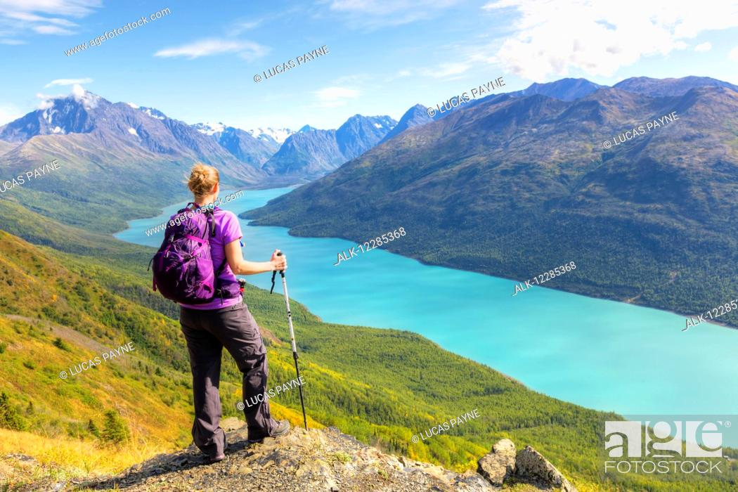 Imagen: Female hiker overlooking Eklutna Lake from Twin Peaks Trail, Chugach State Park, Southcentral Alaska, summer.