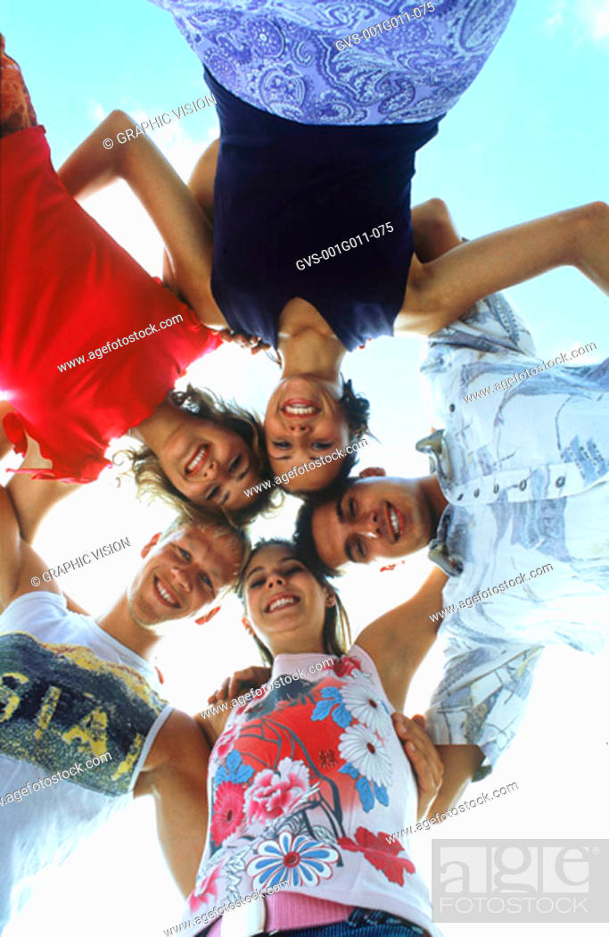 Stock Photo: Portrait of a group of young people standing in a huddle.