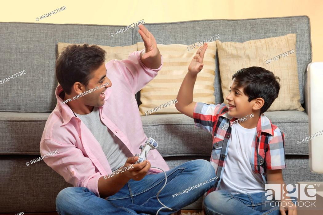 Stock Photo: Father and Son Playing Video Game.