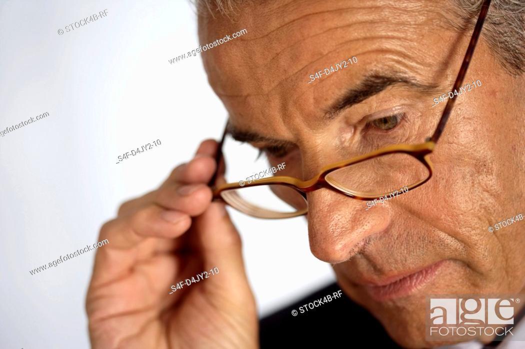 Stock Photo: Senior businessman wearing spectacles.