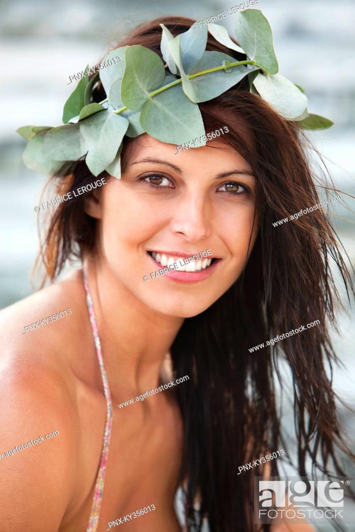 Stock Photo: Woman with crown of leaves at a spa.