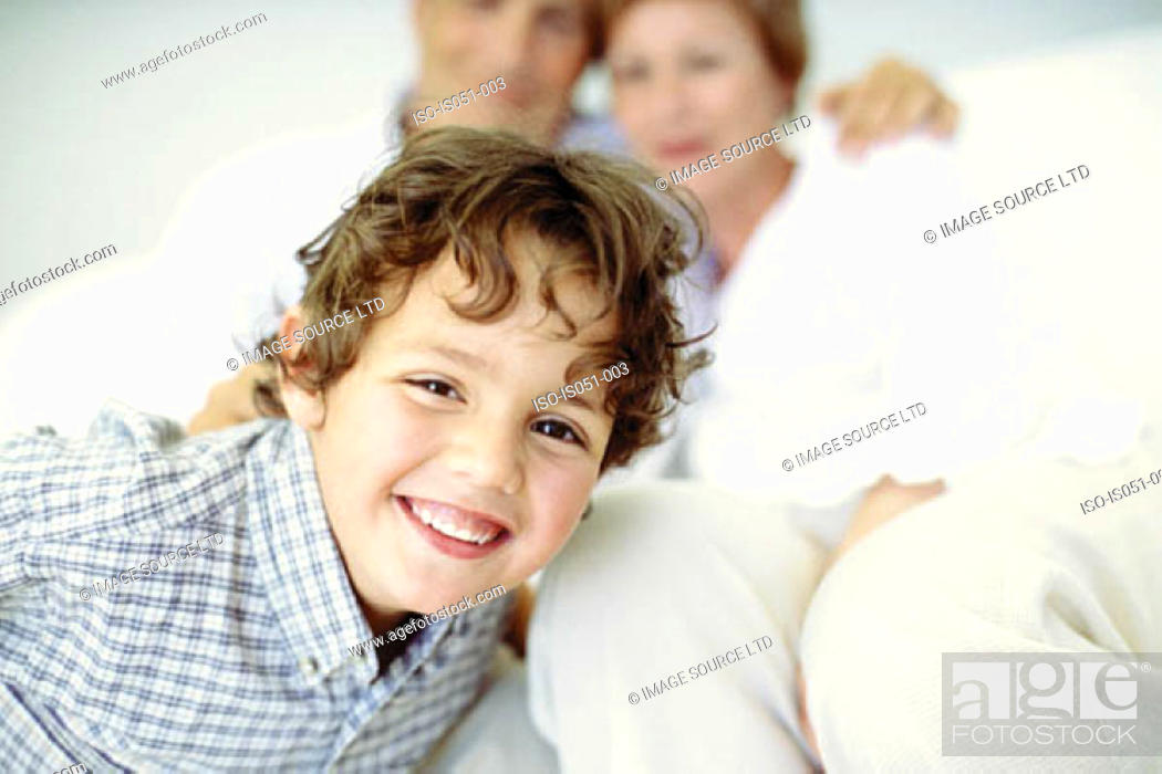 Stock Photo: Smiley boy with grandparents.