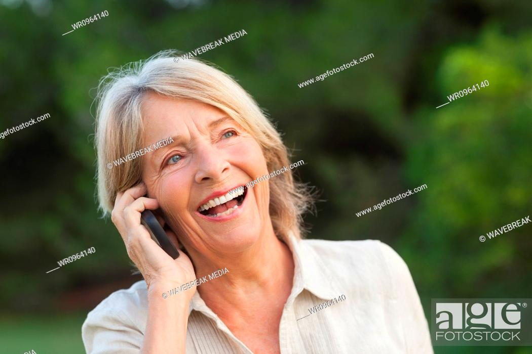 Stock Photo: Woman laughing on the phone.