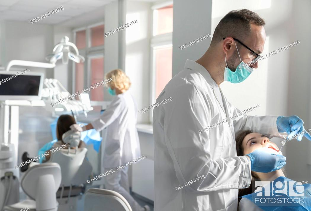 Stock Photo: Young woman getting dental treatment in clinic.