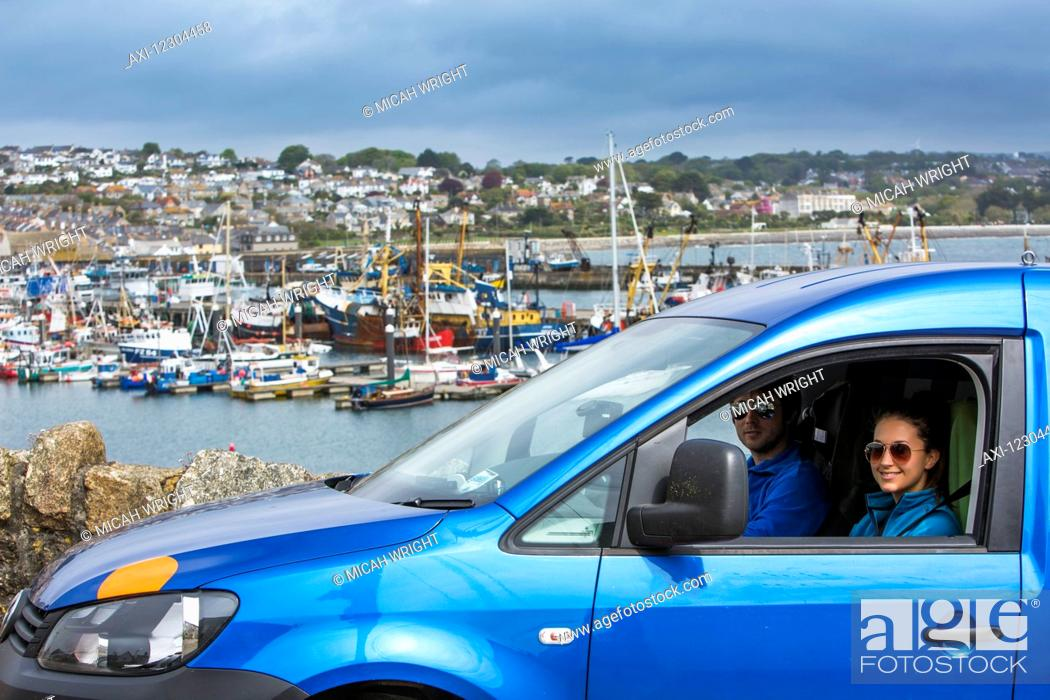 Stock Photo: Friends explore Newlyn, a small fishing village on the South Western tip of Cornwall; Newlyn, Cornwall, England.