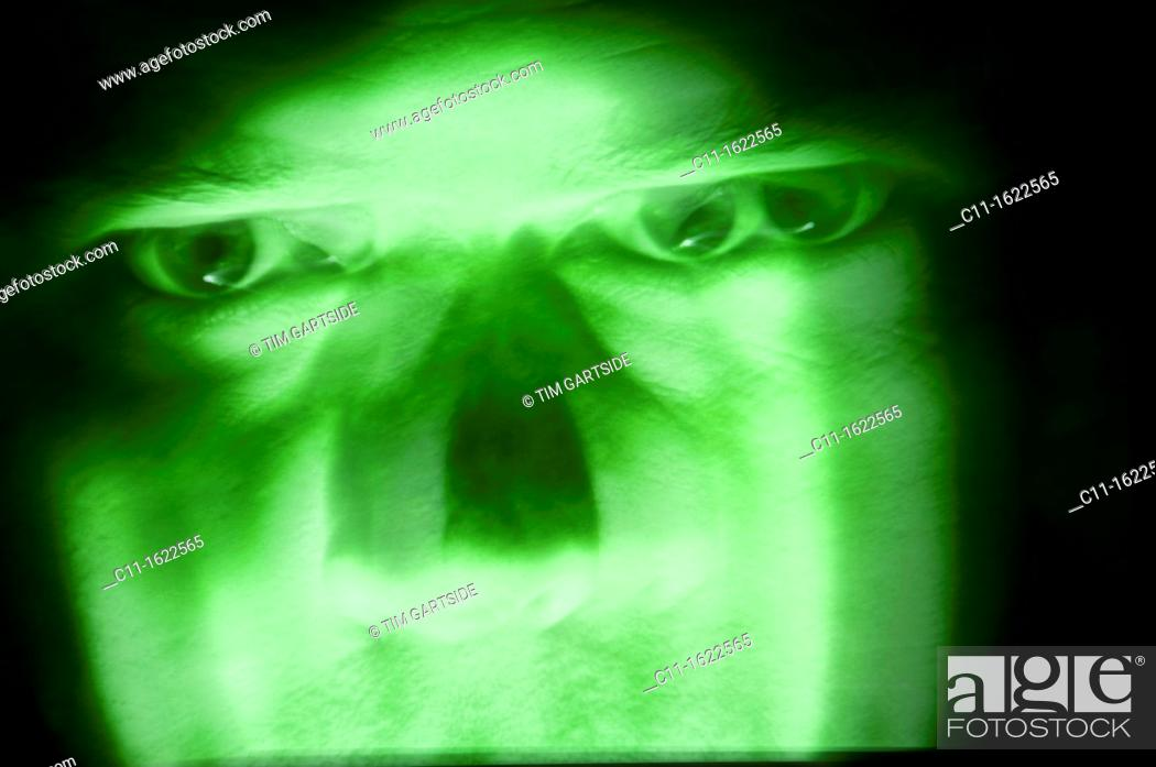 Stock Photo: green evil menacing face.