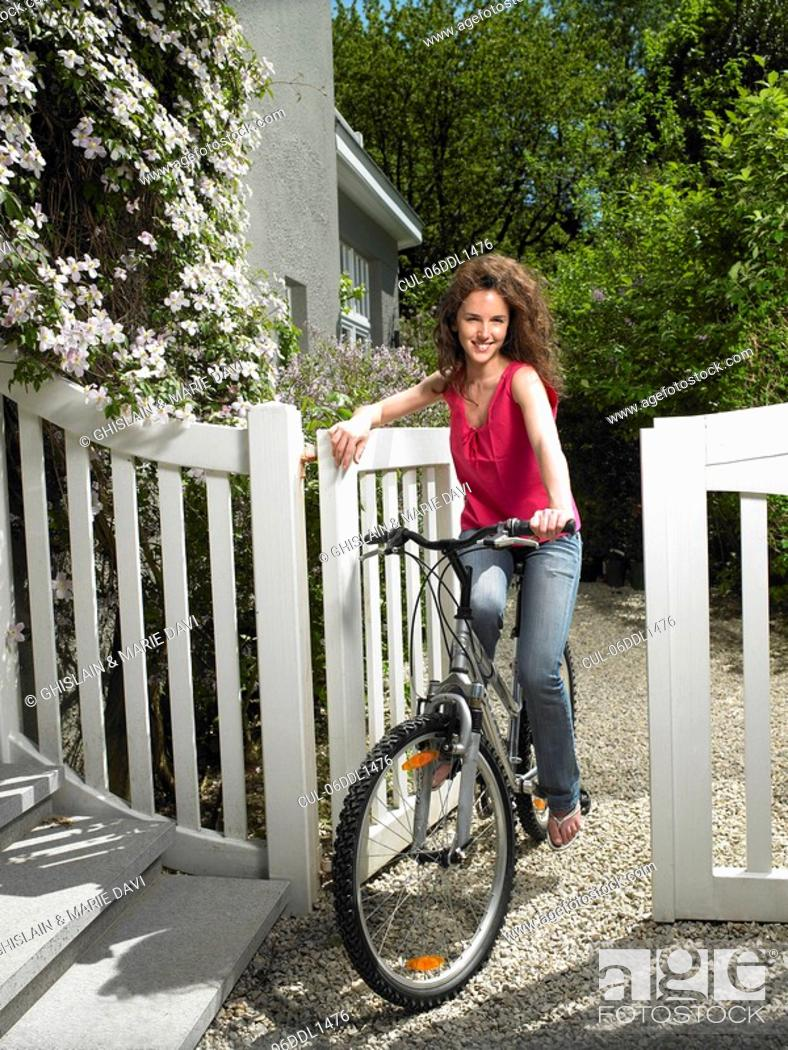 Stock Photo: Woman riding her bicycle.