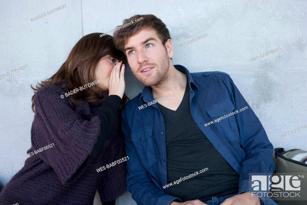 Stock Photo: Germany, Leipzig, University students sitting and whispering.