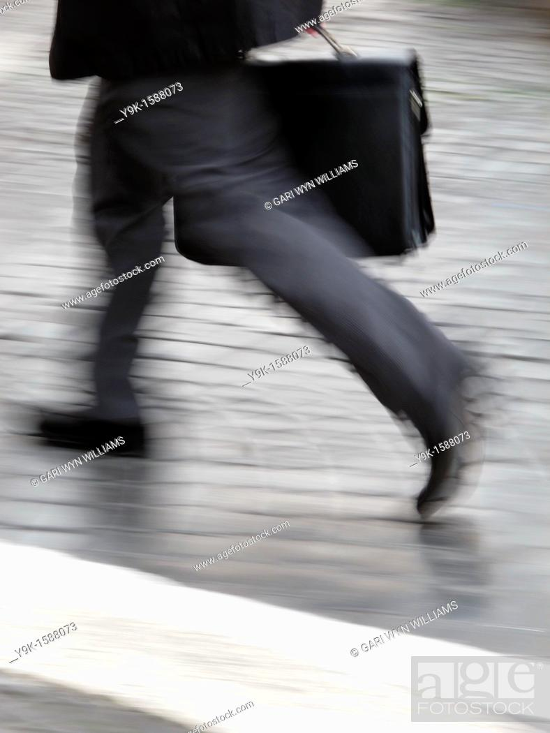 Stock Photo: Commuter with briefcase in city town.