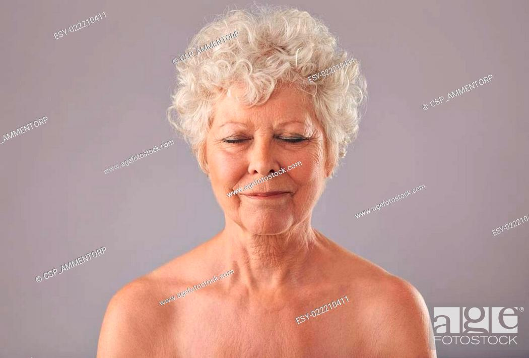 Stock Photo: Relaxed old woman in thought.