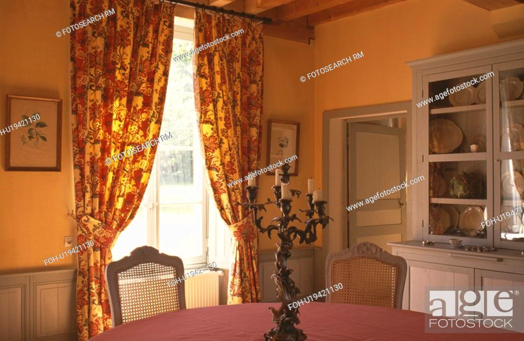 Yellow And Red Floral Curtains In Diningroom With Yellow Walls And Grey Paintwork Stock Photo Picture And Rights Managed Image Pic Foh U19421130 Agefotostock