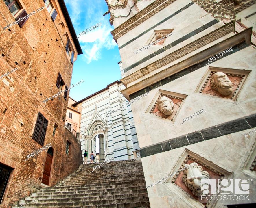 Stock Photo: At right Battistero di San Giovanni, Baptistry of St. John, Siena Cathedral, San Giovanni scuare, Siena, UNESCO World Heritage Site, Tuscany, Italy, Europe.
