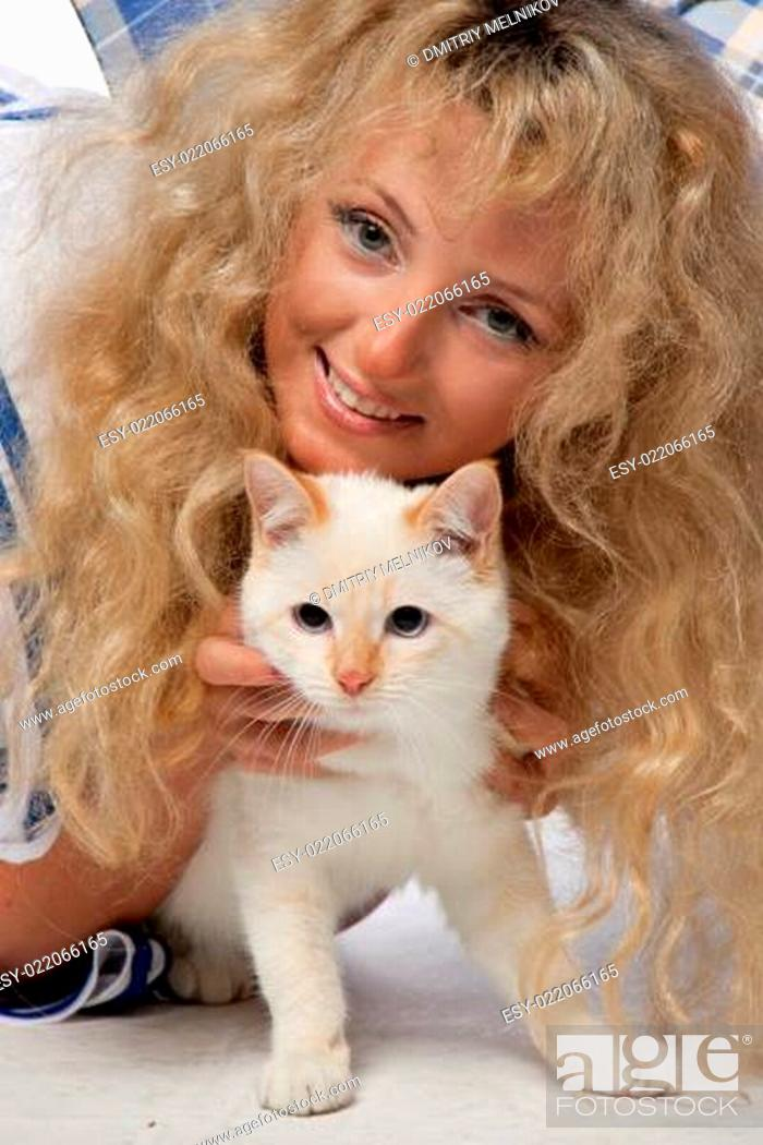 Stock Photo: Girl with a kitten.