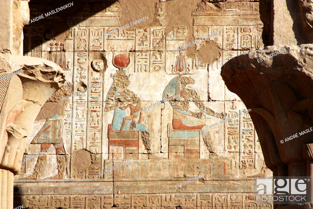 Stock Photo: Original hieroglyphs and paintings of Isis in Horus temple in Edfu, Egypt; in the old times, first chistians tried to destroy their faces.