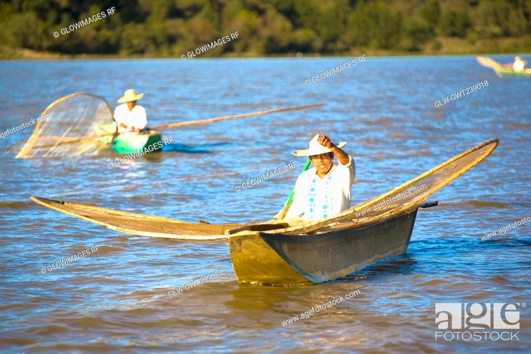 Stock Photo: Fishermen with butterfly fishing nets in a lake.
